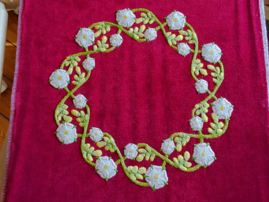 Plantagenet Wreath embroidery stitched to the background fabric