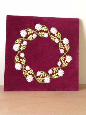 Plantagenet Wreath embroidery stretched onto board
