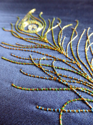 Detail of peacock feather in goldwork embroidery