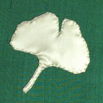 The appliquéd shape, stitched down and with the tacking stitches removed