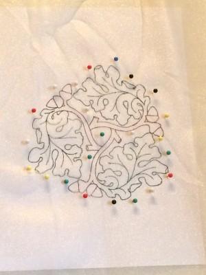 Oak leaf embroidery design drawn onto fabric