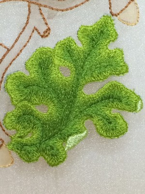 Close-up of a finished embroidered leaf