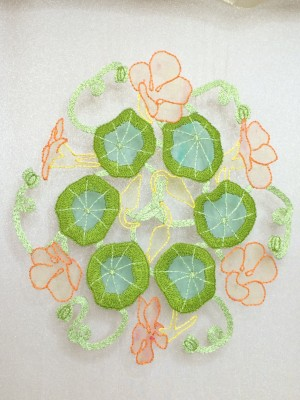 The outer portion of each nasturtium leaf worked in long and short stitch