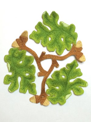 Cut out embroidered oak leaves motif