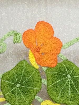 Embroidered nasturtium flower