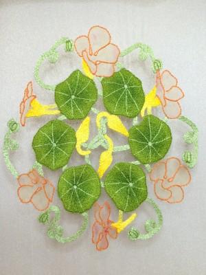 Partly embroidered nasturtium flowers