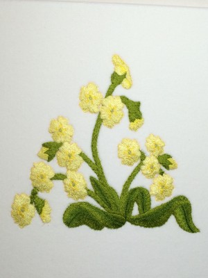 Detailed embroidered picture of primroses