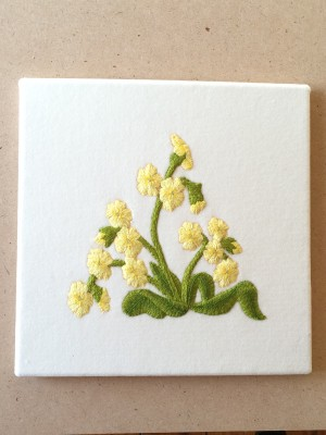 Embroidered picture of primroses