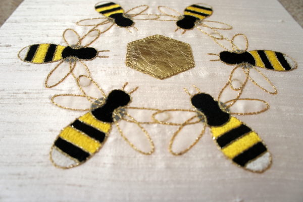 Close-up of embroidered bees