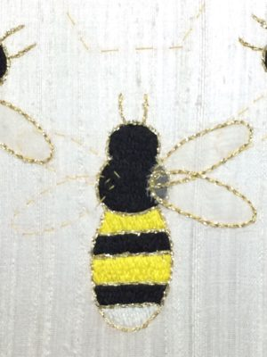 Trimmed and outlined appliqué bee wing