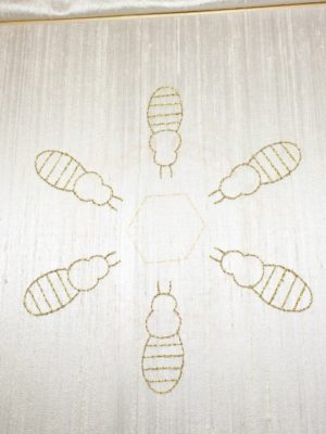 Embroidered outline of the bees
