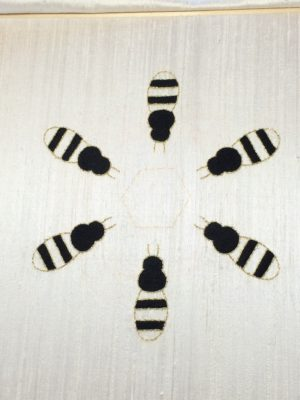 Bees with the black sections embroidered