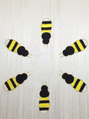 Bees completely embroidered in long and short stitch