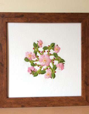 Framed embroidered picture of dog roses