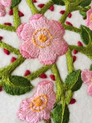 Close-up of embroidered wild roses