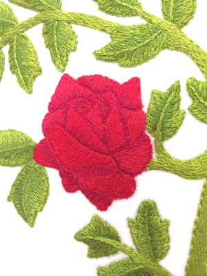 Close up of embroidered rose detail