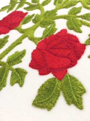 Detail of long and short stitched rose showing shading